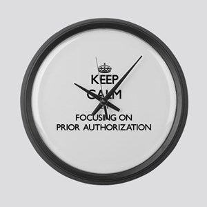Keep Calm by focusing on Prior Au Large Wall Clock