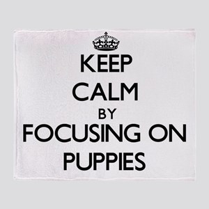 Keep Calm by focusing on Puppies Throw Blanket