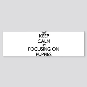 Keep Calm by focusing on Puppies Bumper Sticker
