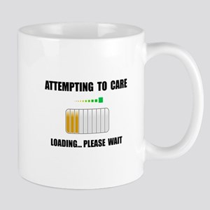 Attempting To Care Mugs