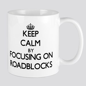 Keep Calm by focusing on Roadblocks Mugs