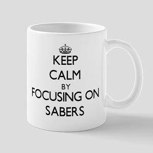 Keep Calm by focusing on Sabers Mugs