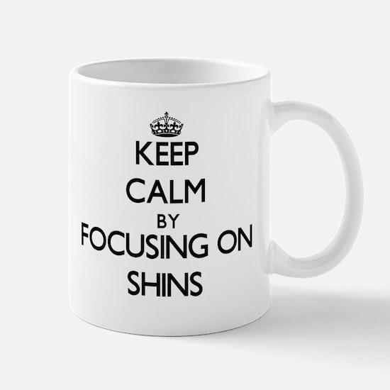 Keep Calm by focusing on Shins Mugs