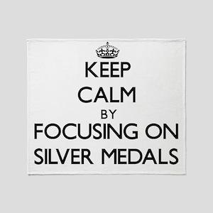 Keep Calm by focusing on Silver Meda Throw Blanket