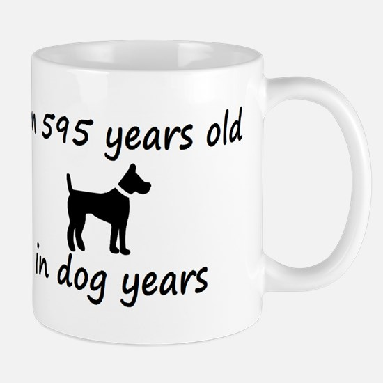 85 dog years black dog 2 Mugs