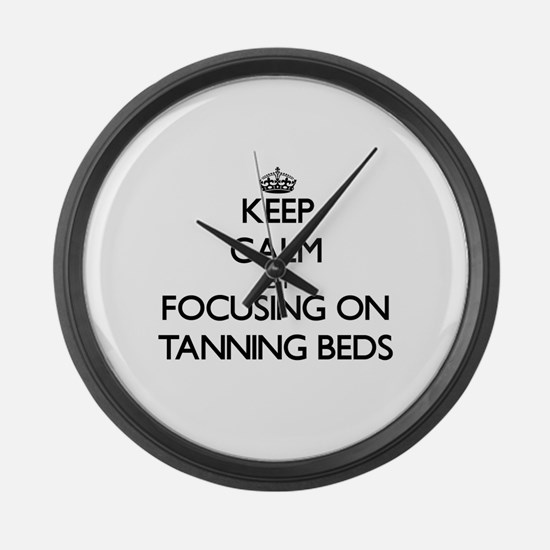 Keep Calm by focusing on Tanning Large Wall Clock