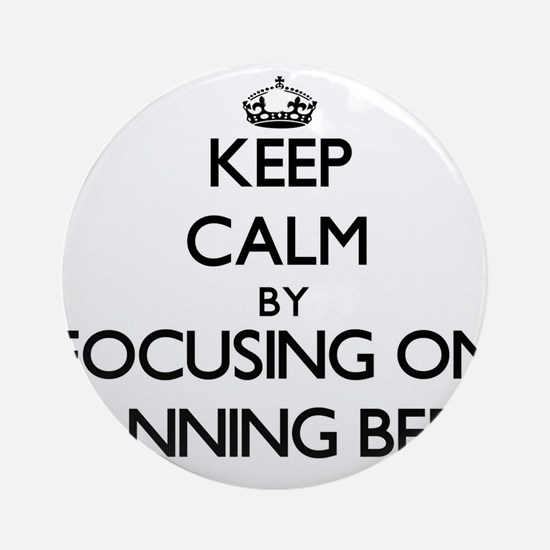 Keep Calm by focusing on Tanning Ornament (Round)