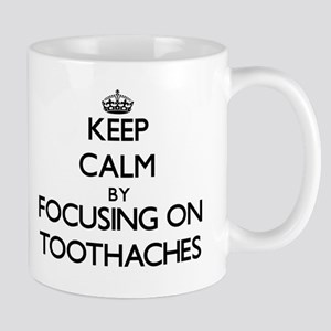 Keep Calm by focusing on Toothaches Mugs