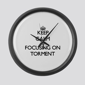 Keep Calm by focusing on Torment Large Wall Clock