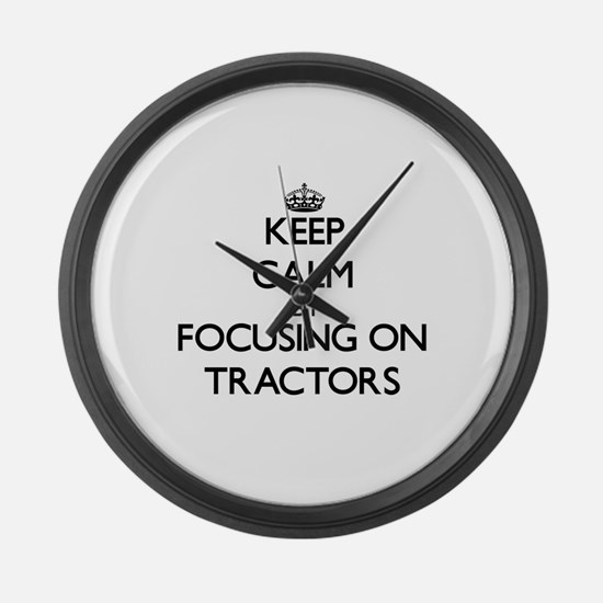 Keep Calm by focusing on Tractors Large Wall Clock