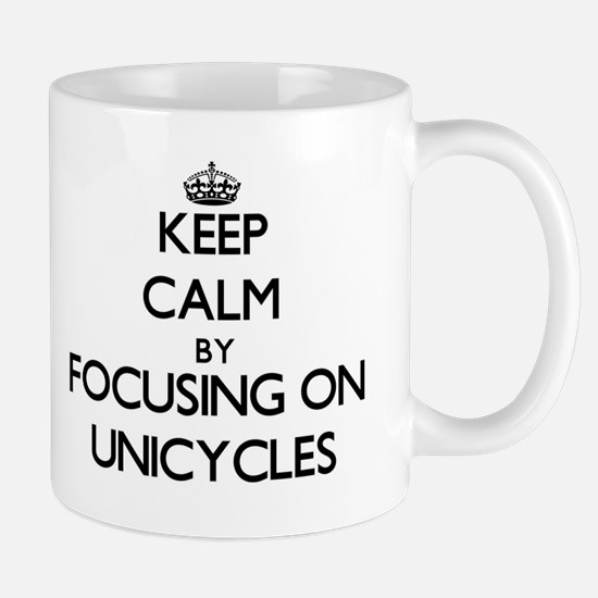 Keep Calm by focusing on Unicycles Mugs