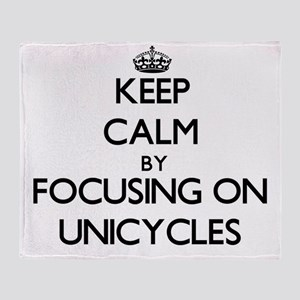 Keep Calm by focusing on Unicycles Throw Blanket