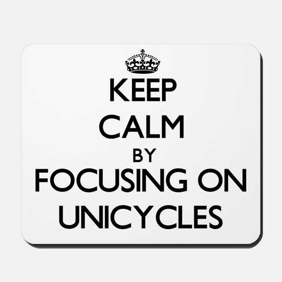 Keep Calm by focusing on Unicycles Mousepad