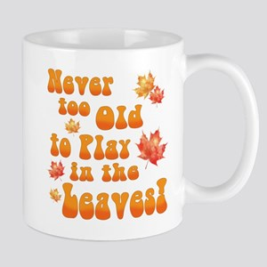 Playing in Leaves Mugs