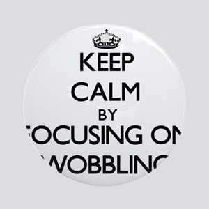 Keep Calm by focusing on Wobbling Ornament (Round)