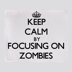 Keep Calm by focusing on Zombies Throw Blanket