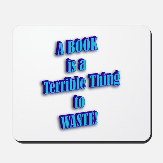 A BOOK IS A TERRIBLE THING TO Mousepad