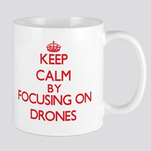 Keep Calm by focusing on Drones Mugs