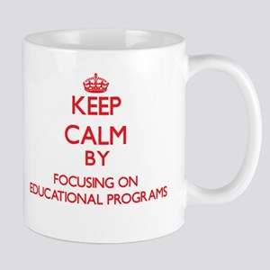Keep Calm by focusing on EDUCATIONAL PROGRAMS Mugs