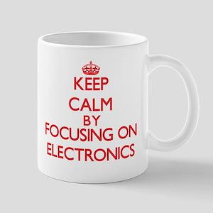Keep Calm by focusing on ELECTRONICS Mugs