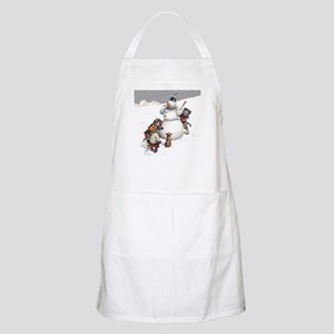 Kittens Play in The Snow Apron
