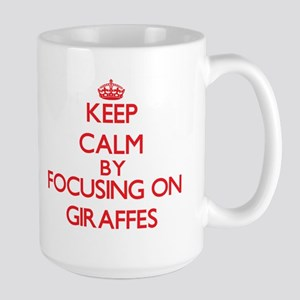 Keep Calm by focusing on Giraffes Mugs