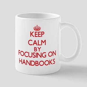 Keep Calm by focusing on Handbooks Mugs