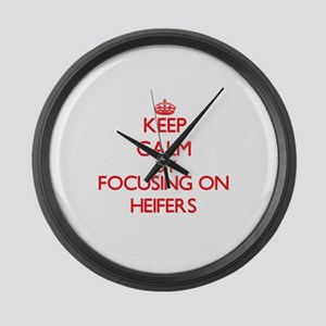 Keep Calm by focusing on Heifers Large Wall Clock