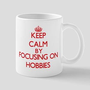 Keep Calm by focusing on Hobbies Mugs