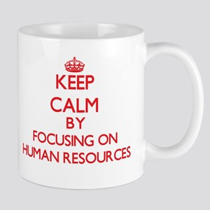 Keep Calm by focusing on Human Resources Mugs