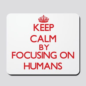 Keep Calm by focusing on Humans Mousepad