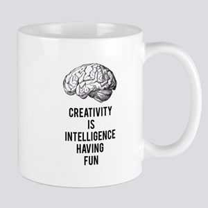 creativity is intelligence having fun Mugs