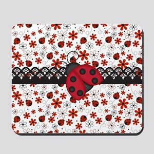 Charming Ladybugs and Red Flowers Mousepad