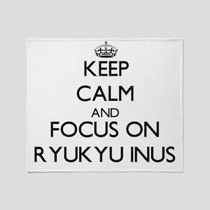 Keep calm and focus on Ryukyu Inus Throw Blanket