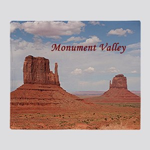 Monument Valley (caption) Throw Blanket