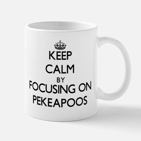Keep calm by focusing on Pekeapoos Mugs