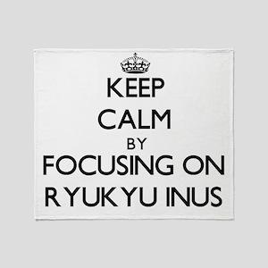 Keep calm by focusing on Ryukyu Inus Throw Blanket
