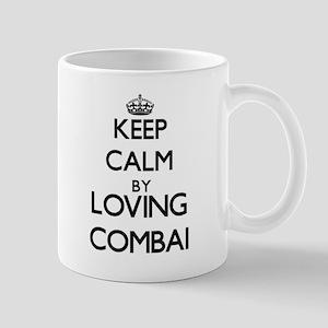 Keep calm by loving Combai Mugs