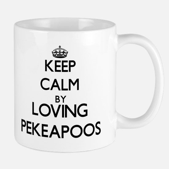 Keep calm by loving Pekeapoos Mugs