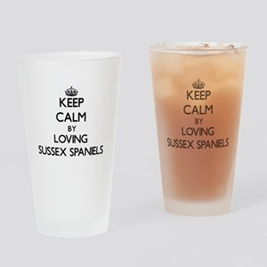 Keep calm by loving Sussex Spaniels Drinking Glass