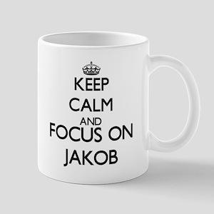 Keep Calm and Focus on Jakob Mugs