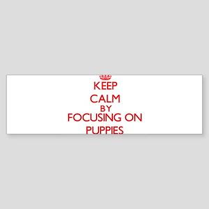 Keep Calm by focusing on Puppies Bumper Sticker