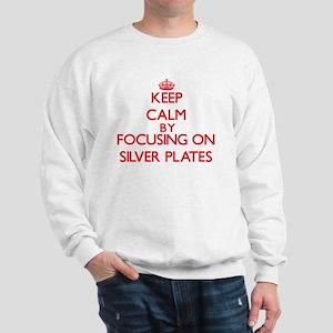 Keep Calm by focusing on Silver Plates Sweatshirt
