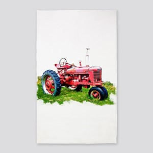 Red Tractor in the Grass Area Rug