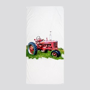 Red Tractor in the Grass Beach Towel