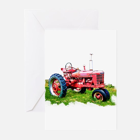 Red Tractor in the Grass Greeting Cards
