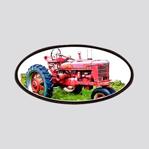 f9155b5b3c9 Red Tractor in the Grass Patches