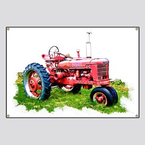 Red Tractor in the Grass Banner