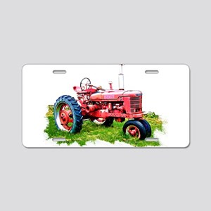 Red Tractor in the Grass Aluminum License Plate