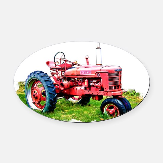 Red Tractor in the Grass Oval Car Magnet